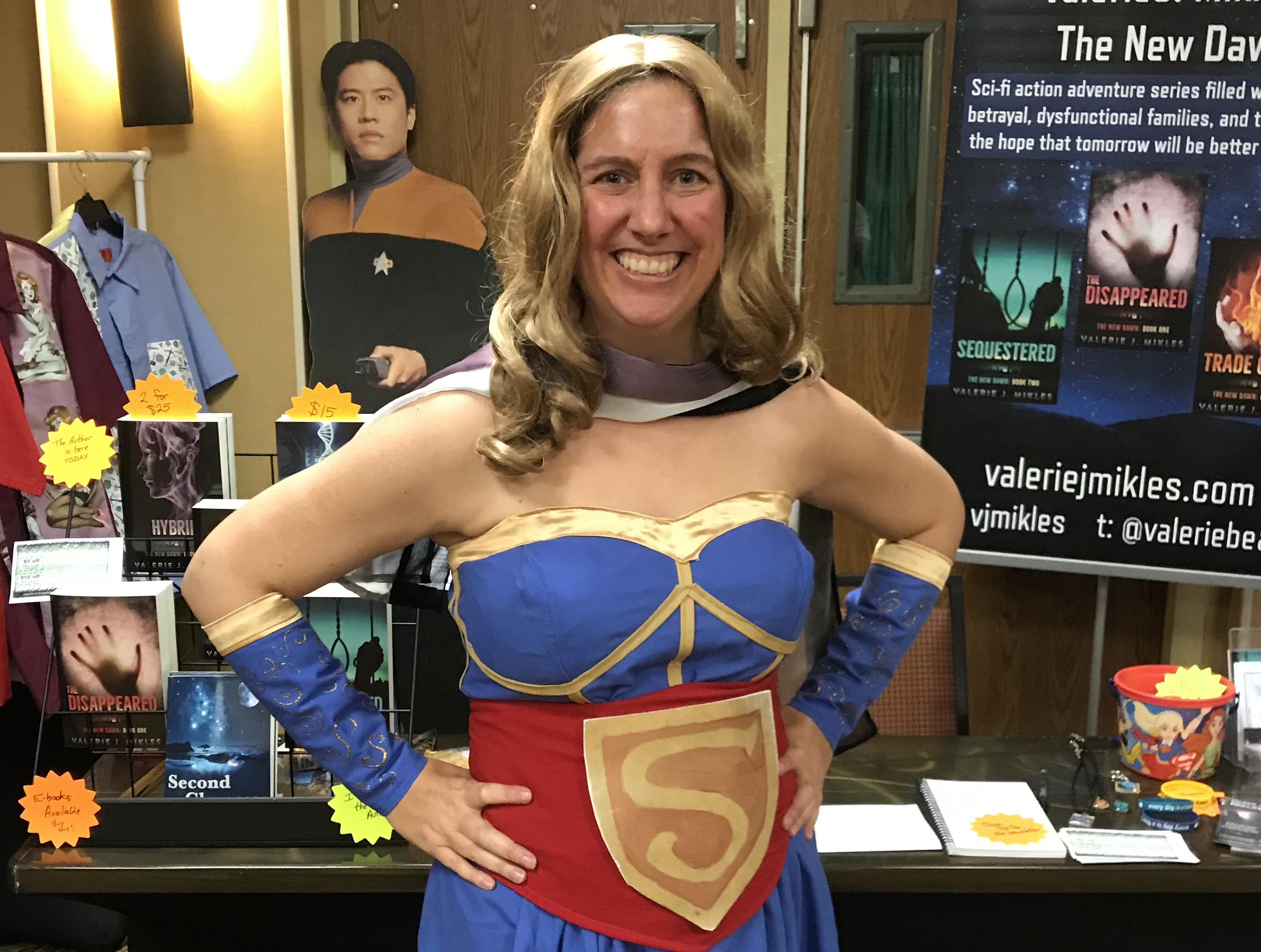 Me in a Supergirl costume and selling books